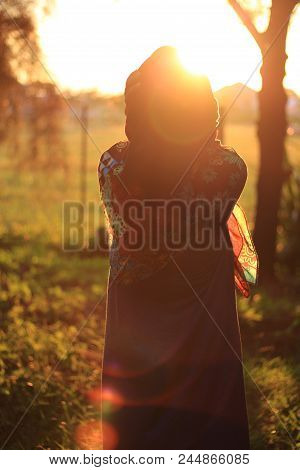 Closeup Of Happy Girl Feeling Cold Outdoor In The City. Young Woman Holding Scarf And Looking At Cam