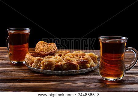 Turkish Sweet Baklava On Plate With Turkish Tea.