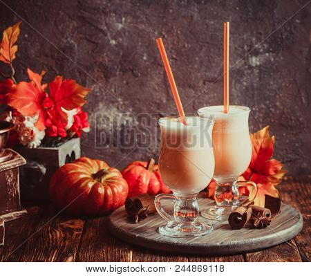 Pumpkin Milk Coctail With Spices In Glass. Hot Autumnal Pumpkin Warming Up Drink
