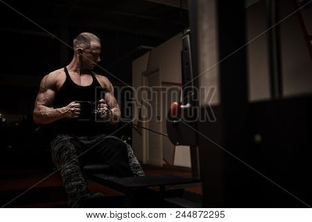 Muscular Tough Man In Gym Posing, Shallow Depth Of Field