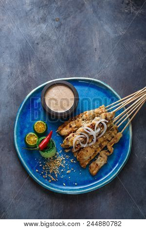 Indonesian Chicken Skewers Sate With Peanut Sauce And Salad, Top View, Copyspace.