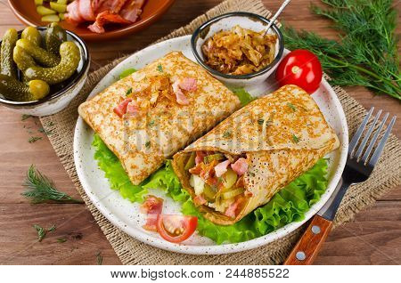Savory Pancakes Stuffed With Mashed Potatoes, Pickles And Bacon. Traditional Russian Food