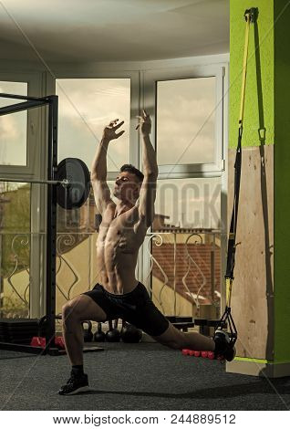 Instructor Of Bodybuilding. Sport And Gym Concept. Man With Nude Torso In Gym Enjoy Training, Trx. M