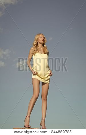 Girl Against The Sky. Hot Sexy Girl. Girl With Sexy Legs, Loneliness. Woman In Summer On Blue Sky Ba