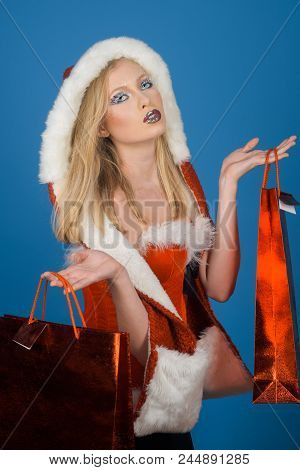 Attractive Woman In Santa Costume. Winter, Christmas, New Year, Shopping, Happiness Concept - Beauti
