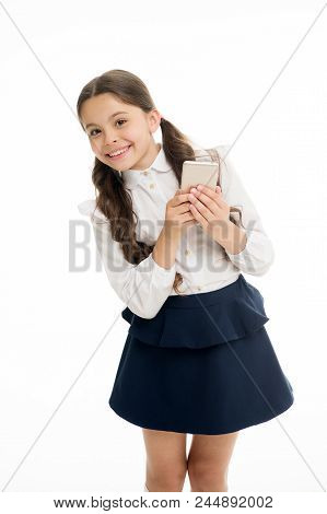 Girl Cute Long Curly Hair Holds Smartphone White Background. Child Girl School Uniform Clothes Holds