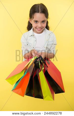 Kid Girl Happy Smiling Face Carries Bunch Packages Yellow Background. Birthday Girl Concept. Girl Li