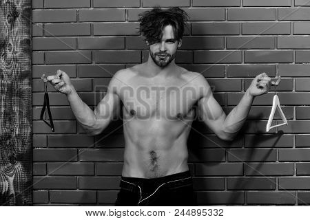 Man With Hangers. Bearded Man, Caucasian Hipster With Moustache With Muscular Torso, Chest And Body,