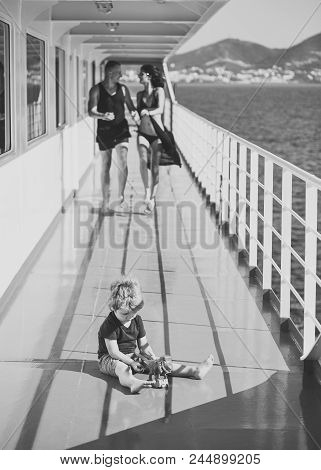 Childish Loneliness. Family Travelling On Cruise Ship, Defocused. Family Rest Concept. Father, Mothe