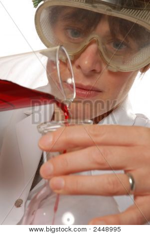 Confident Lady Technician Pouring Liquid