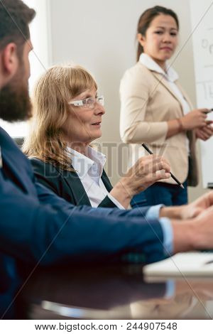 Portrait of a middle-aged woman with an impressive career in the top management of a successful company during business meeting in the office