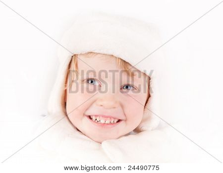 Cheerful Girl In Winter Hat With Ear Flaps