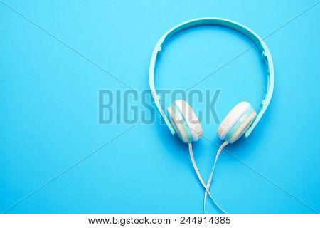 Image of white headphones for music from above