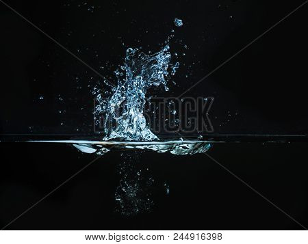 Droplet Of Water Dropped Into Liquid And Photographed While Making Splash On Surface. Water Splash I