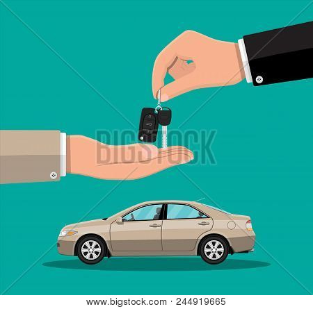 Hand Gives Car Keys To Another Hand. Buy, Rental Or Lease Car. Exhibition Pavilion, Showroom Or Deal