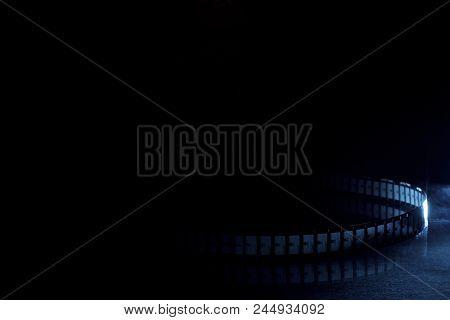 Old 35mm Movie Film On Dark Background
