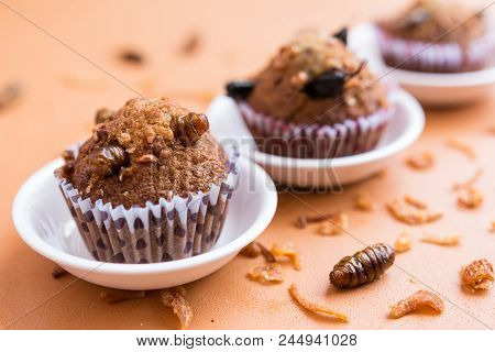 Insect Food In A Banana Cupcake With Black Coffee In A White Cup. Healthy Meal High Protein Diet Con