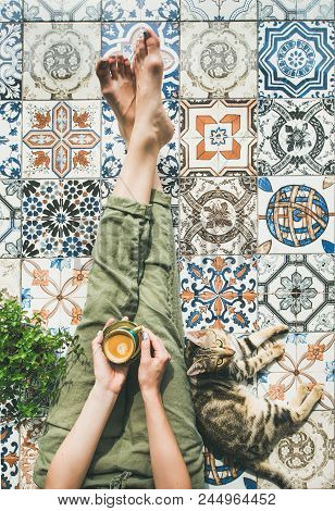 Lazy Morning On Terrace. Flat-lay Of Womans Legs In Cosy Linen Pants, Plant, Cat And Cup Of Coffee I