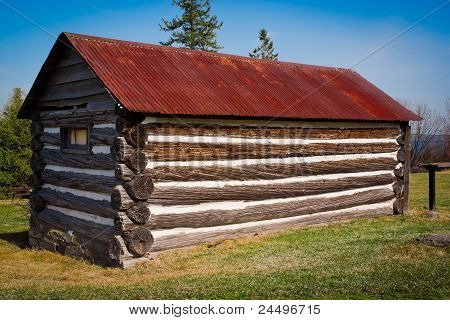Very Small, Old Log Cabin With Rusted Tin Roof