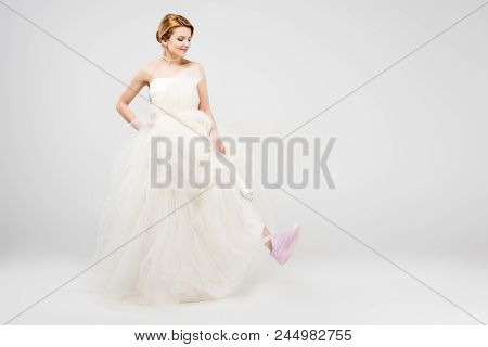 Cheerful Bride In White Wedding Dress And Pink Sneakers, Isolated On Grey, Feminism Concept