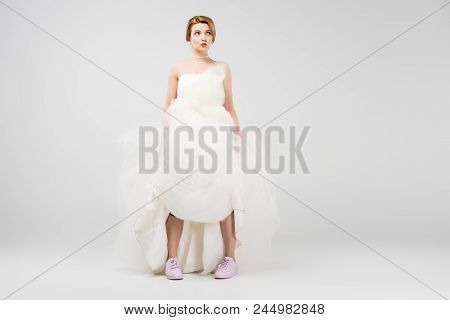 Happy Bride In White Wedding Dress And Pink Sneakers, Isolated On Grey, Feminism Concept
