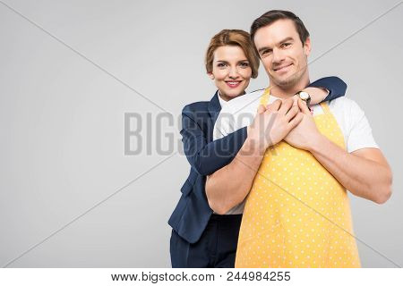 Businesswoman And Male Householder Hugging Together, Feminism Concept, Isolated On Grey