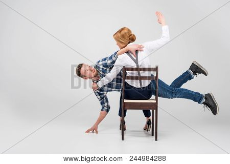 Feminist Woman Beating Her Husband, Feminism Concept, Isolated On Grey