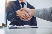 Handshake of cooperation customer and salesman after agreement, successful car loan contract buying or selling new vehicle. poster