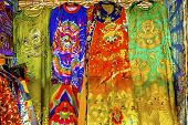 Blue Red Yellow Chinese Dragon Replica Silk Garments Robes Decorations Panjuan Flea Market  Beijing China.  Panjuan Flea Curio market has many fakes, replicas and copies of older Chinese products, many ancient. poster