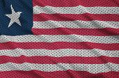 Liberia flag printed on a polyester nylon sportswear mesh fabric with some folds poster