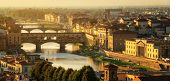 Florence Ponte Vecchio Bridge and City Skyline in Italy. Florence is capital city of the Tuscany region of central Italy. Florence was center of Italy medieval trade and wealthiest cities of past era. poster