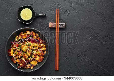 Kung Pao Paneer At Black Slate Background. Kung Pao Paneer Is A Vegetarian Version Of Chinese Sichua