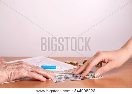 Paper Notes In The Hands Of An Old Woman. Transfer Of Money. Financial Assistance Concept. Senior Ci
