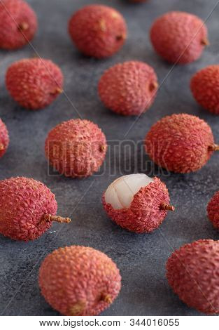 Fresh Litchi Fruits On A Grey Table Close Up