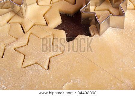 advent cutting cookies stars