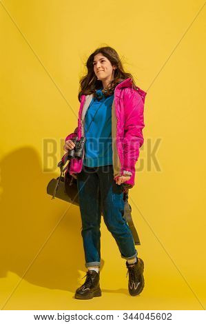 Smiling And Going. Portrait Of A Cheerful Young Caucasian Tourist Girl With Bag And Binoculars Isola