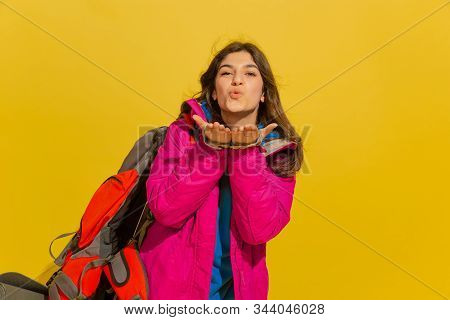 Smiling, Sending Kiss. Portrait Of A Cheerful Young Caucasian Tourist Girl With Bag And Binoculars I