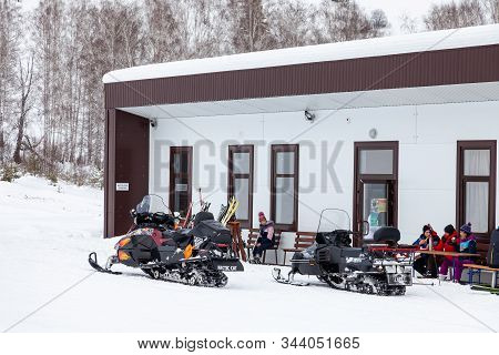 Altai, Russia - 01.01.2020: Snowmobiles Near The Building For The Rental Of Ski Equipment In The Alt