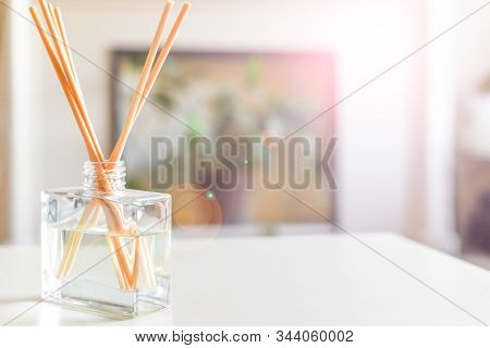 Reed Diffuser To Fragrance Home Interior On The Coffee Table Of A Light Modern Home Living Room