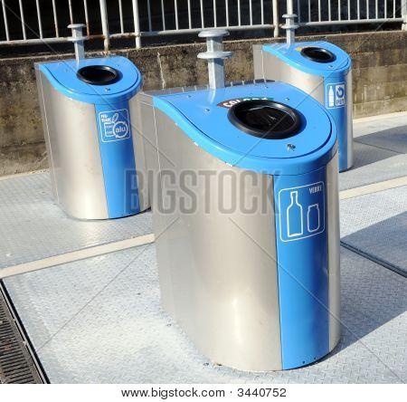 Three Trash Cans