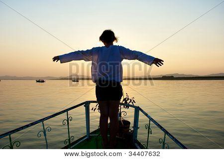 Girl on sunset background