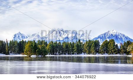 Panoramic View Of A Mountain Lake In Winter Scenery In Slovakia, High Tatras.