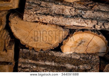 Woodpile Of Firewood Closeup, Visible Texture And Cracks In The Tree. Heating Season, Eco-raw Materi