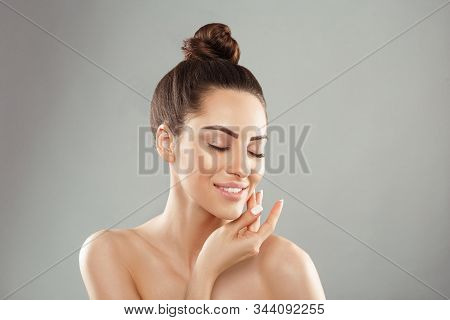 Beauty And Spa Concept. Beautiful Young Woman With Clean Fresh Skin Touch Face. Facial Treatment. Gi