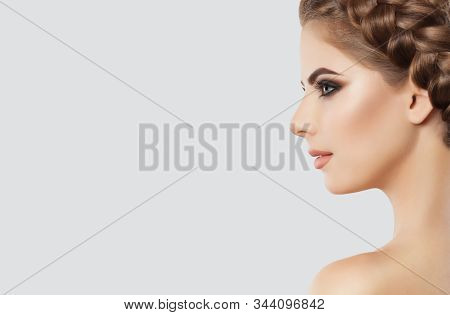Portrait Of A Beautiful Happy Woman With Long Eyelashes, Beautiful Make-up, Thick Eyebrows And With