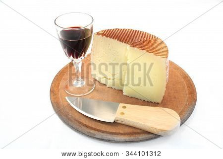 Gourmet Snack In The Cheeseboard With A Knife And A Glass Of Wine.