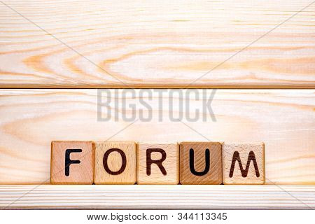 Forum Word Concept. The Word Forum On Wooden Cubes. Forum As Steps To Progress Our Business. Forum T