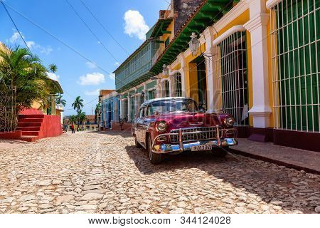 Trinidad, Cuba - June 08, 2019: Collectible Car In The Old Streets Of A Small Cuban Town During A Vi