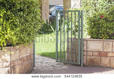 Open Green Wicket Made Of Metal Inviting To Enter
