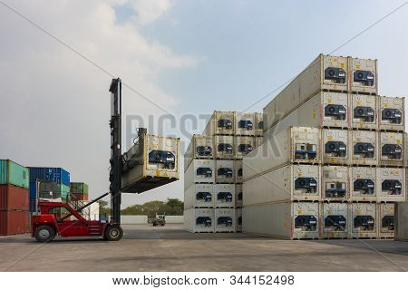 Forklift Reach Stacker Is Lifting The Reefer Container In The Container Depot As For Business And Sh
